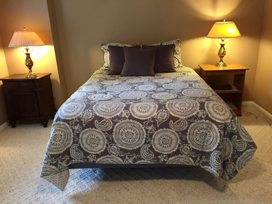 Comfy queen size bed is located in a separate bedroom.