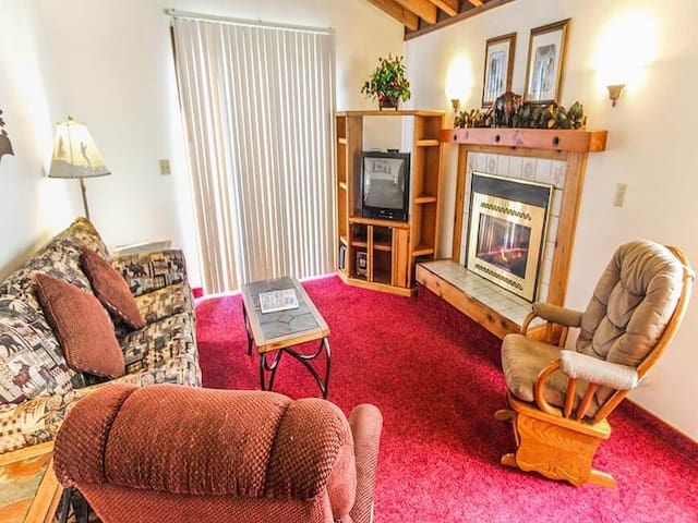 Spacious living room with TV and plenty of seating! - Timbers at Island Park Village Resort