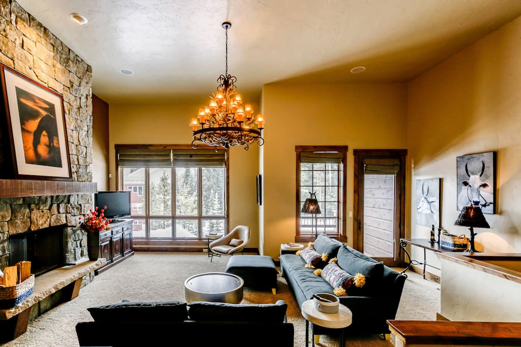 Bright and inviting with large windows to front deck.