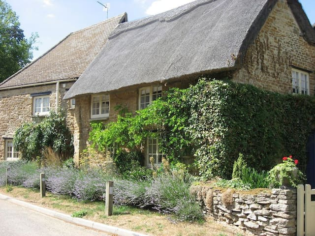 "Thatched Cotswolds gem in ""England's best village"""