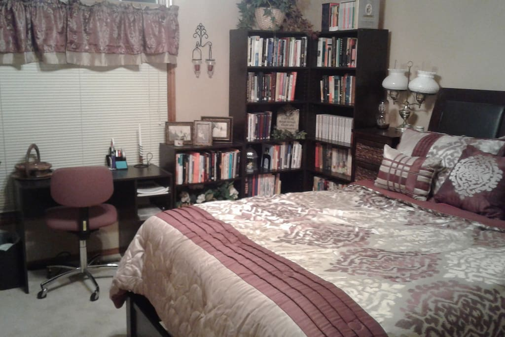 Queen size bed with closet and small desk.  Private bathroom.