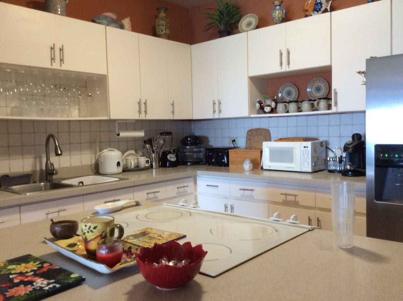 Fully equipped kitchen with microwave , coffeemaker, rice cooker,  convection oven, toaster and blender.