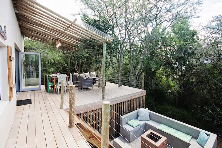 Deck which leads to Fire Pit surrounded by beautiful forest
