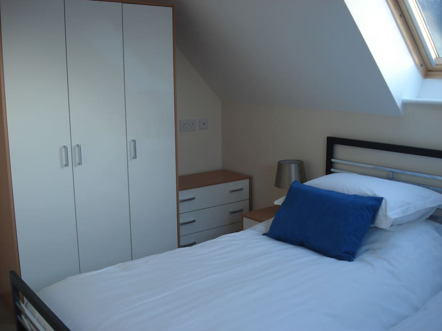 A side view of the twin bedroom, all bed linen and towels provided