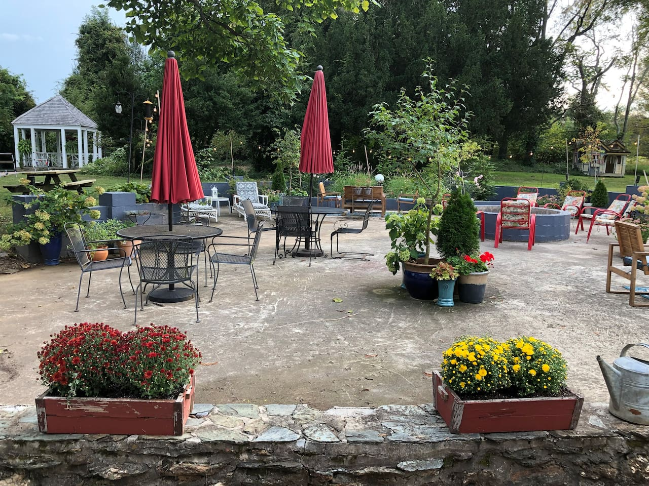 Fall patio landscaped for your outdoor enjoyment with firepit fully stocked with wood! Our guests favorite time spent on the farm all year long is around the huge firepit.
