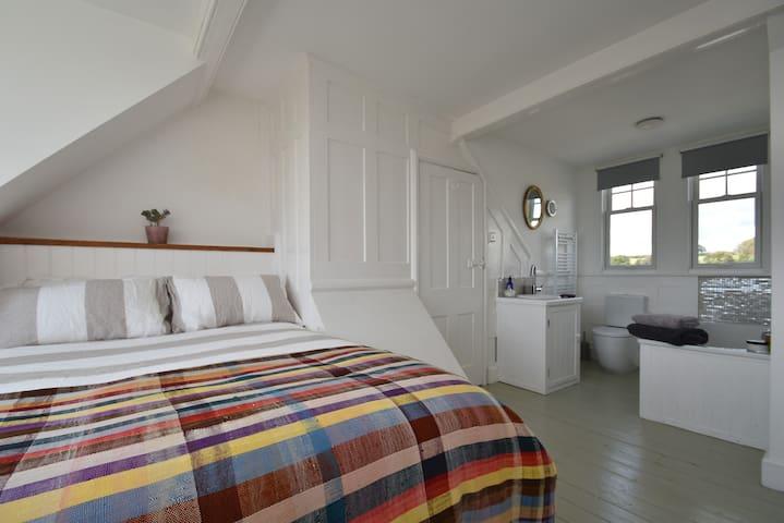 Master bedroom suite with bathroom