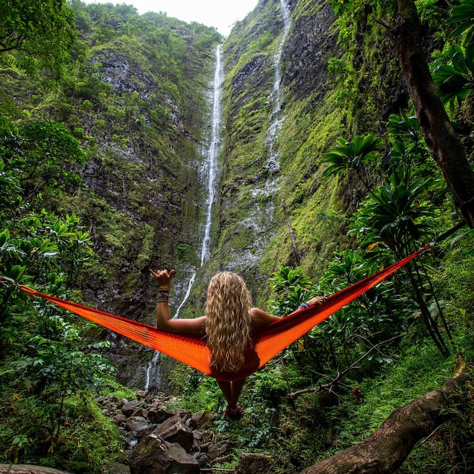 Girl in hammack at waterfall