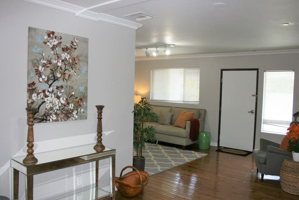 Entry way and foyer with view into living room
