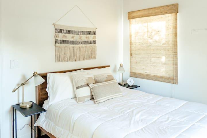 2nd bedroom - queen bed, plenty of natural light