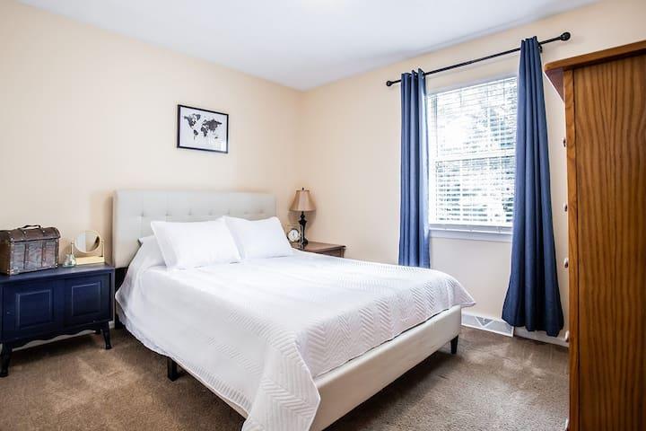 Bedroom 2 of 3 with a queen bed.