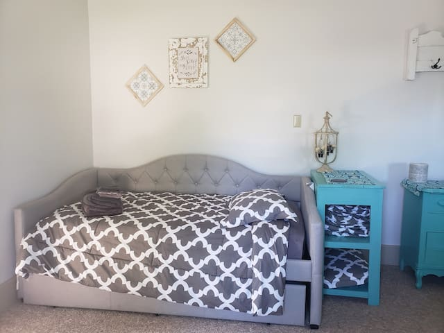 Master bedroom twin daybed with twin trundle.