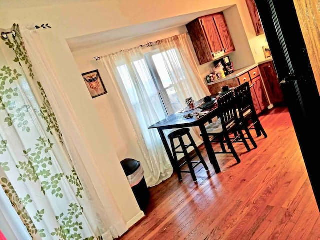 The view of the kitchen from the living room area, with the window facing the view of the Cumberland river.  The door on the left goes to my beautiful from porch with all of the amazing view.