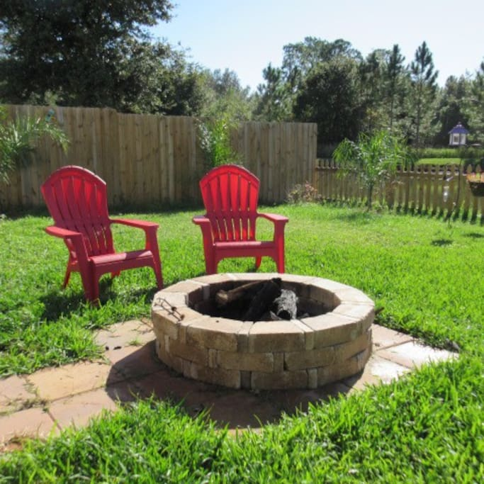 Nice shared backyard for your relaxation. Fire pit and gas grill available.