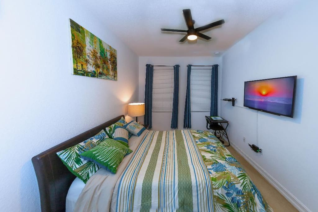 Full bed, work desk and chair, cable TV, central air, ceiling fan.