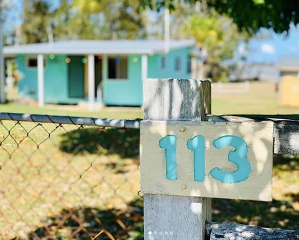 Fibro beach shack on the water opposite Fraser Is