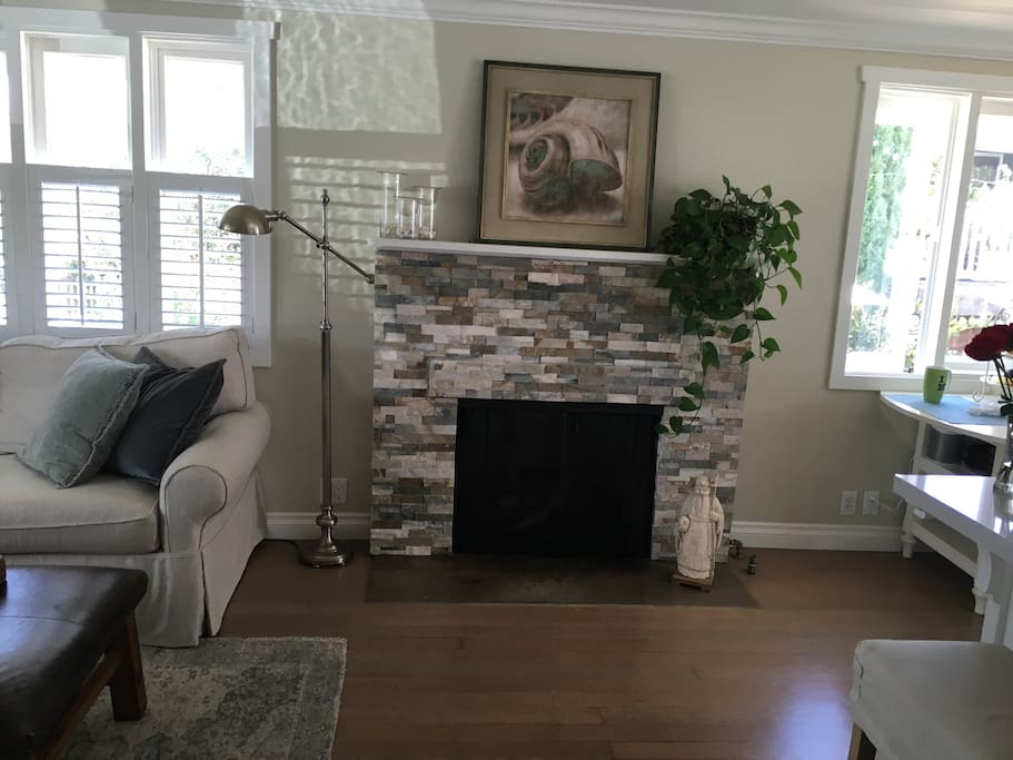 Fire place in open floor living and kitchen area