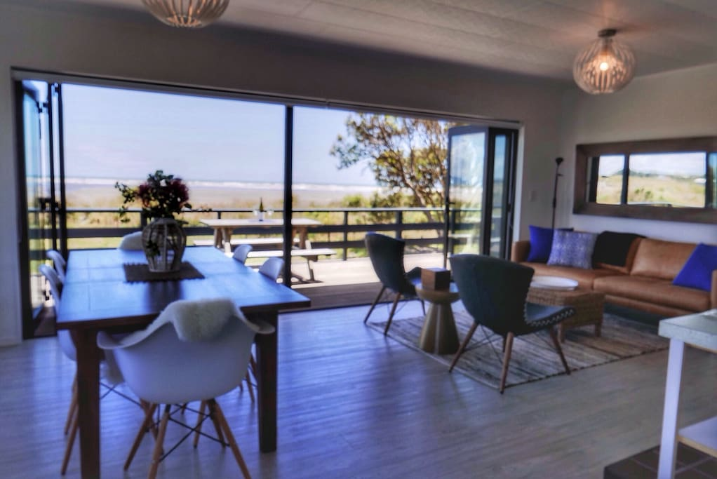 Absolute beach front and stunning sea views  from the sunny open plan living area