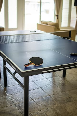 Ping-pong table at community room across from bbq grill.