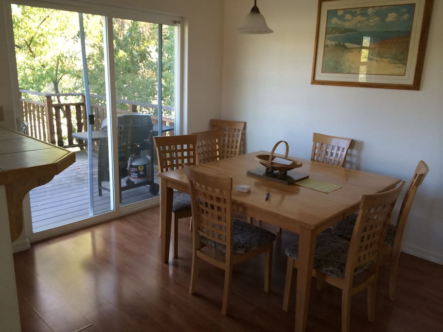 Dining area, next to the Kitchen, opens to the deck