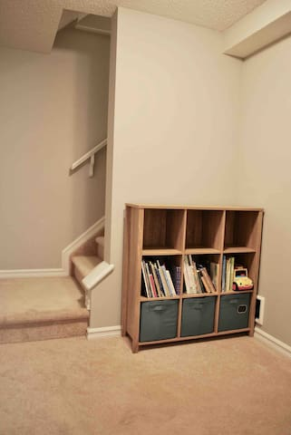 Bookshelf with kids books and toys