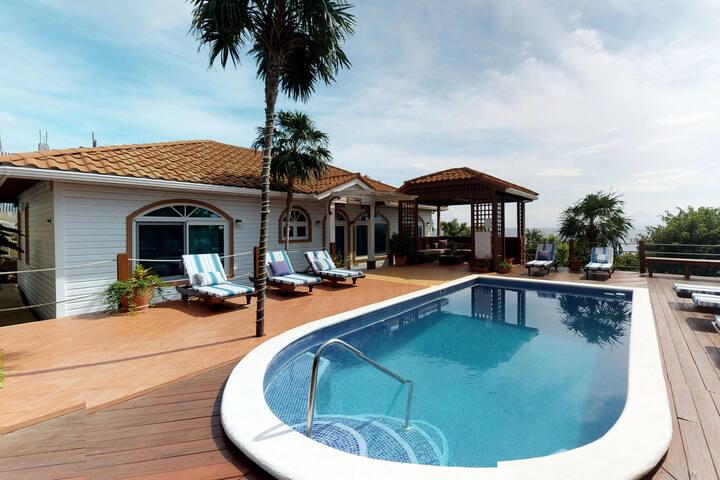 Luxury villa for large groups featuring shared pool, ocean views, nearby beach