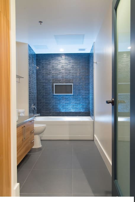 Luxury Spa Bathroom With Glass Doors On Shower. Ralph Lauren Towels, Facial Scrubs, Organic ToothPaste.
