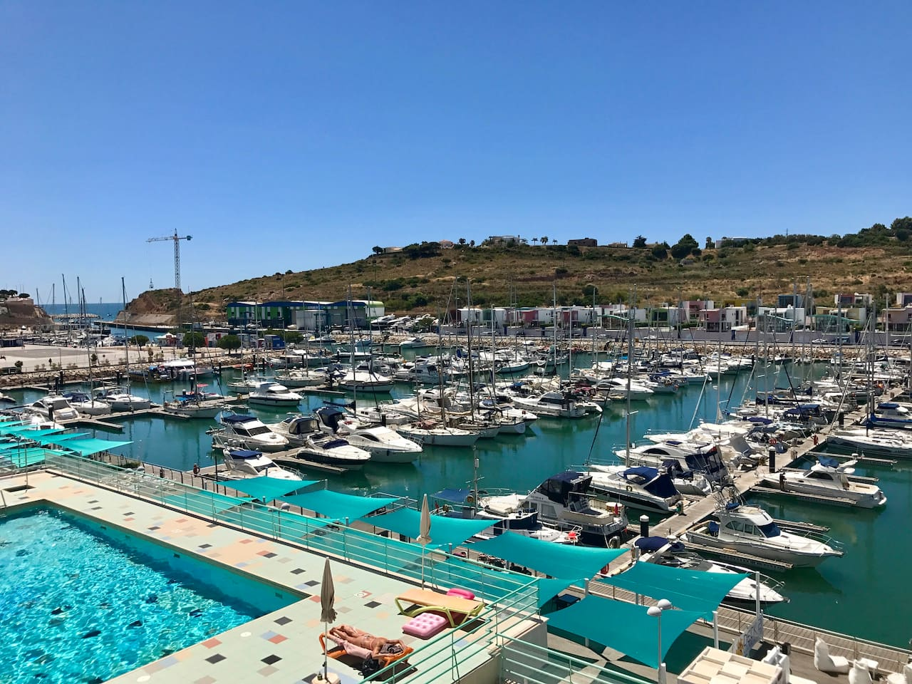 View from main balcony, overlooking pool, marina, marina restaurants and ocean in the background.
