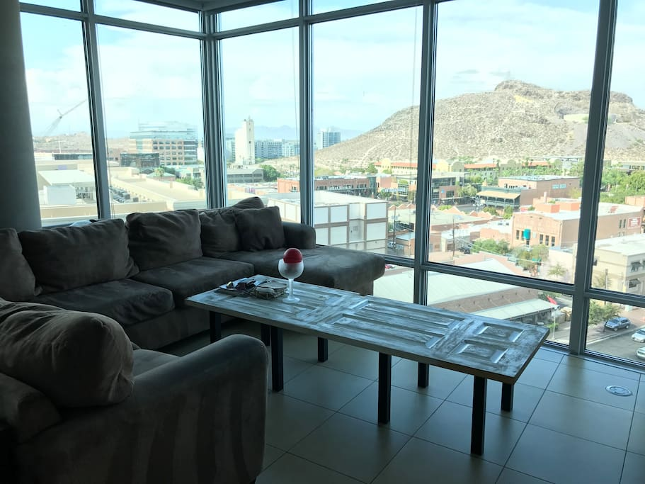 "Living Room, overlooking the city and ""A mountain"""