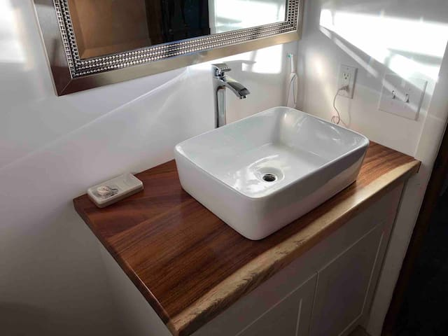 Simple clean bathroom with walk in shower