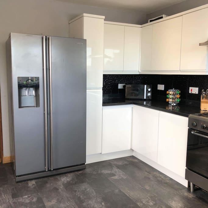 Kitchen with large American style fridge freezer