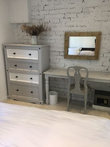 Bedroom, chest of drawers and dressing table
