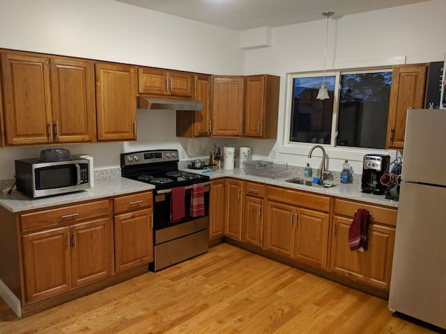 Newly renovated kitchen with stainless steel appliances and quartz countertops