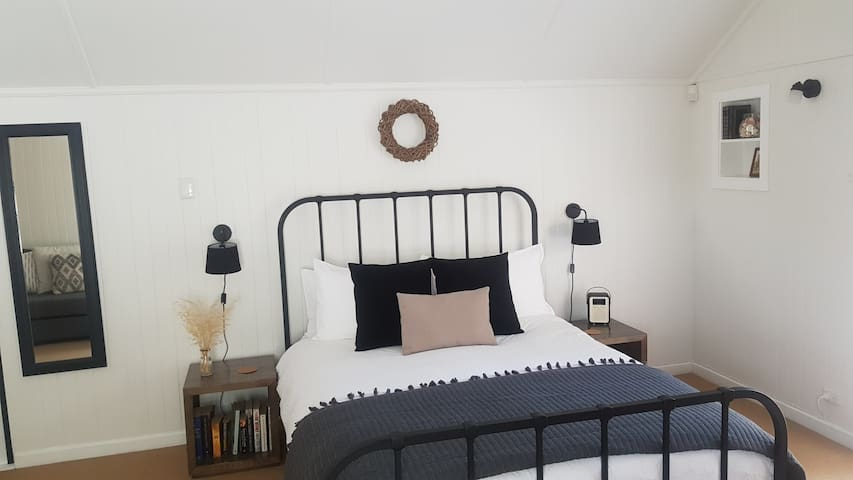 Pillow topped queen mattress with feather pillows.