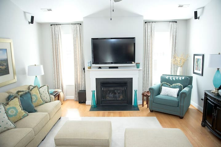 """Great Room with 60"""" TV and lots of seating"""