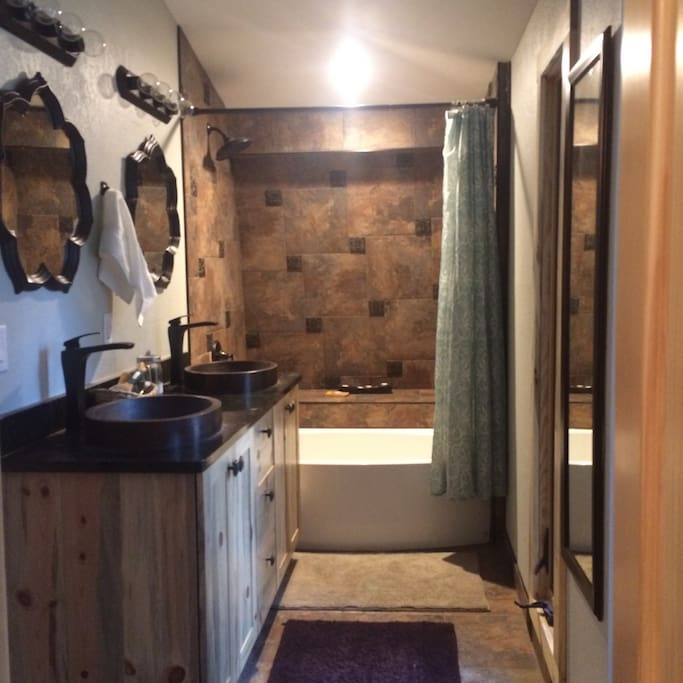 Your bathroom. It is Jack and Jill style, and is shared with one other bedroom that may or not be rented. Your room and the other bedroom are located on the top floor, along with this bathroom.