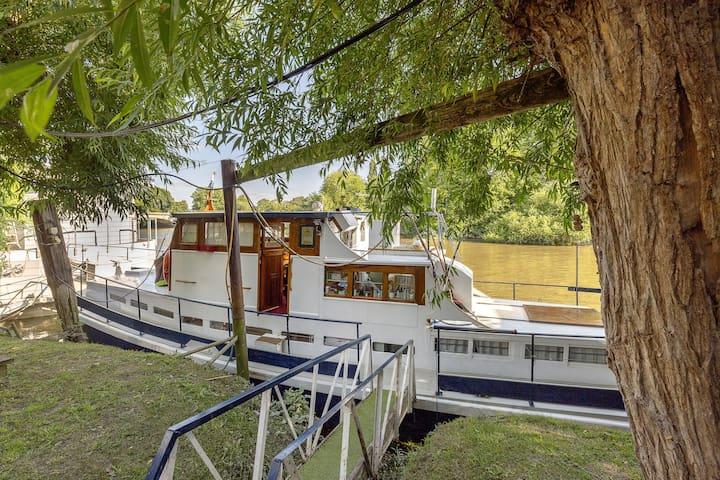 Charming historic boat moored opposite Kew Gardens
