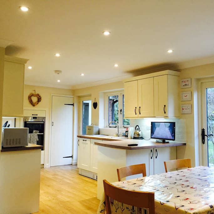 Fully equipped kitchen diner with bi-fold doors onto garden