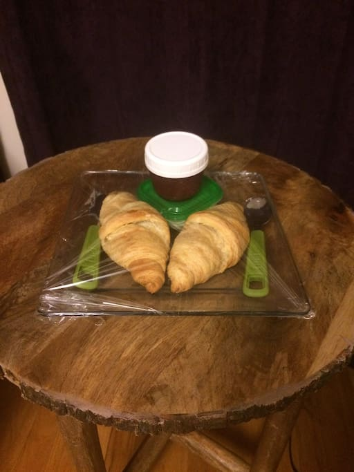 Fresh baked croissants w/ butter and jam on arrival