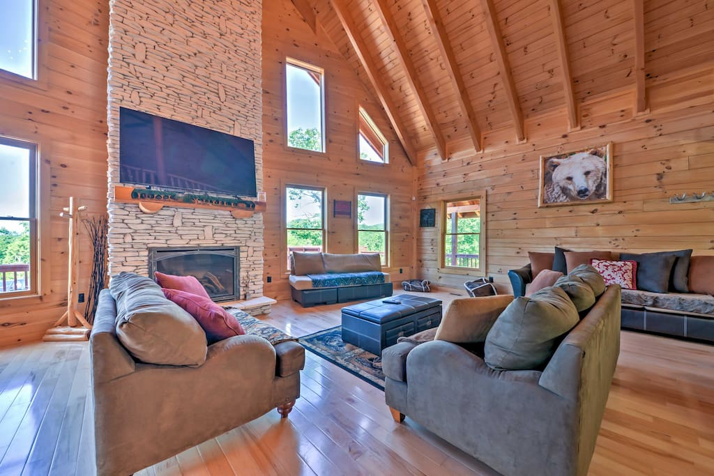 Kick back and relax in the living room, which boasts a massive stone fireplace.
