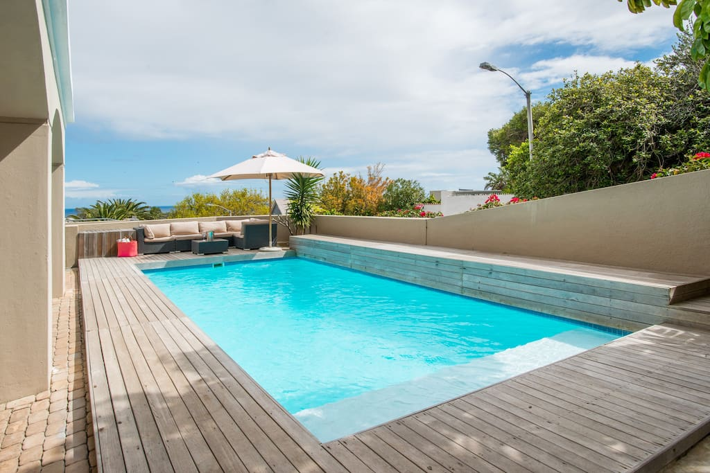 Large Amazing Salt Water pool with sun loungers and comfy couches