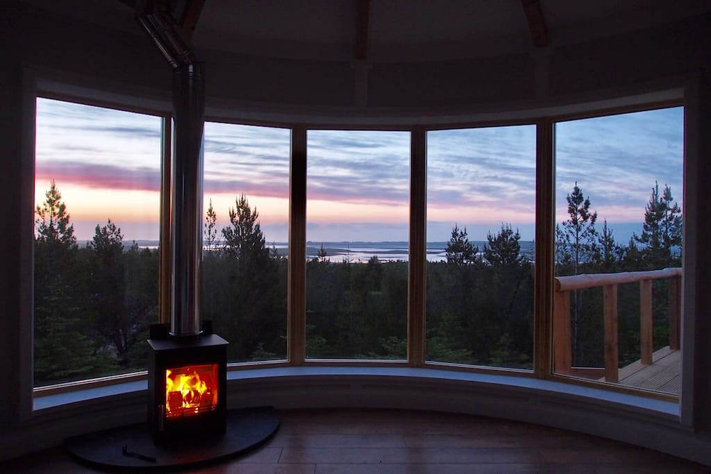 Sunset skies and cosy wood burning stove. Your forest retreat on North Uist, Outer Hebrides