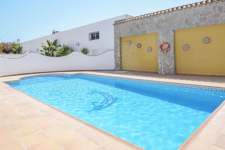 Beautiful Villa Fuentes with Private Terrace, Shared Pool & Garden; Parking Available, Pets Allowed on Request