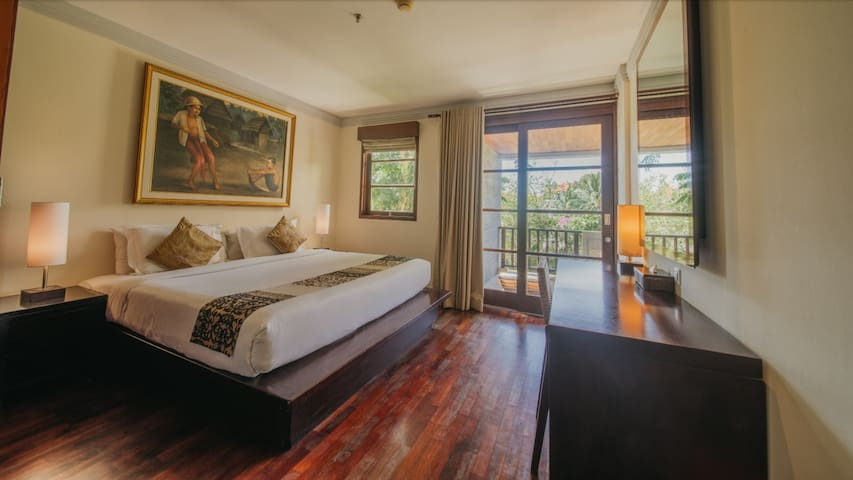 Second bed room with King size bed. It has balcony view to main garden and pools.