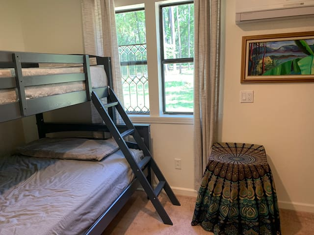 Bedroom with full bed (bottom) and twin bed (top). Ladder access.