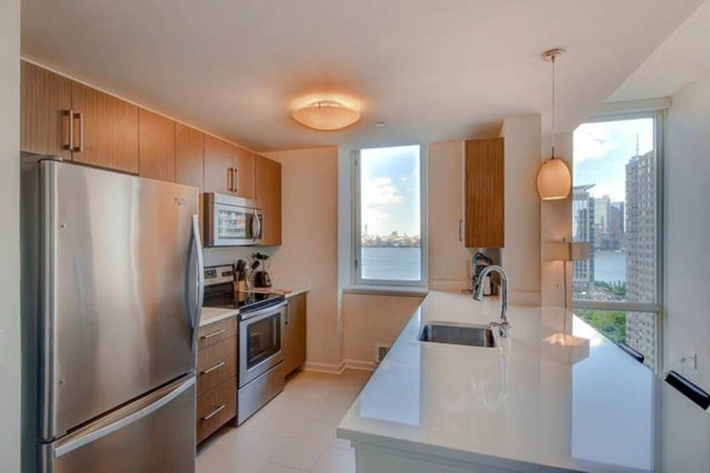 Fully equipped kitchen with full size stainless steel appliances, pots, pans and dishes
