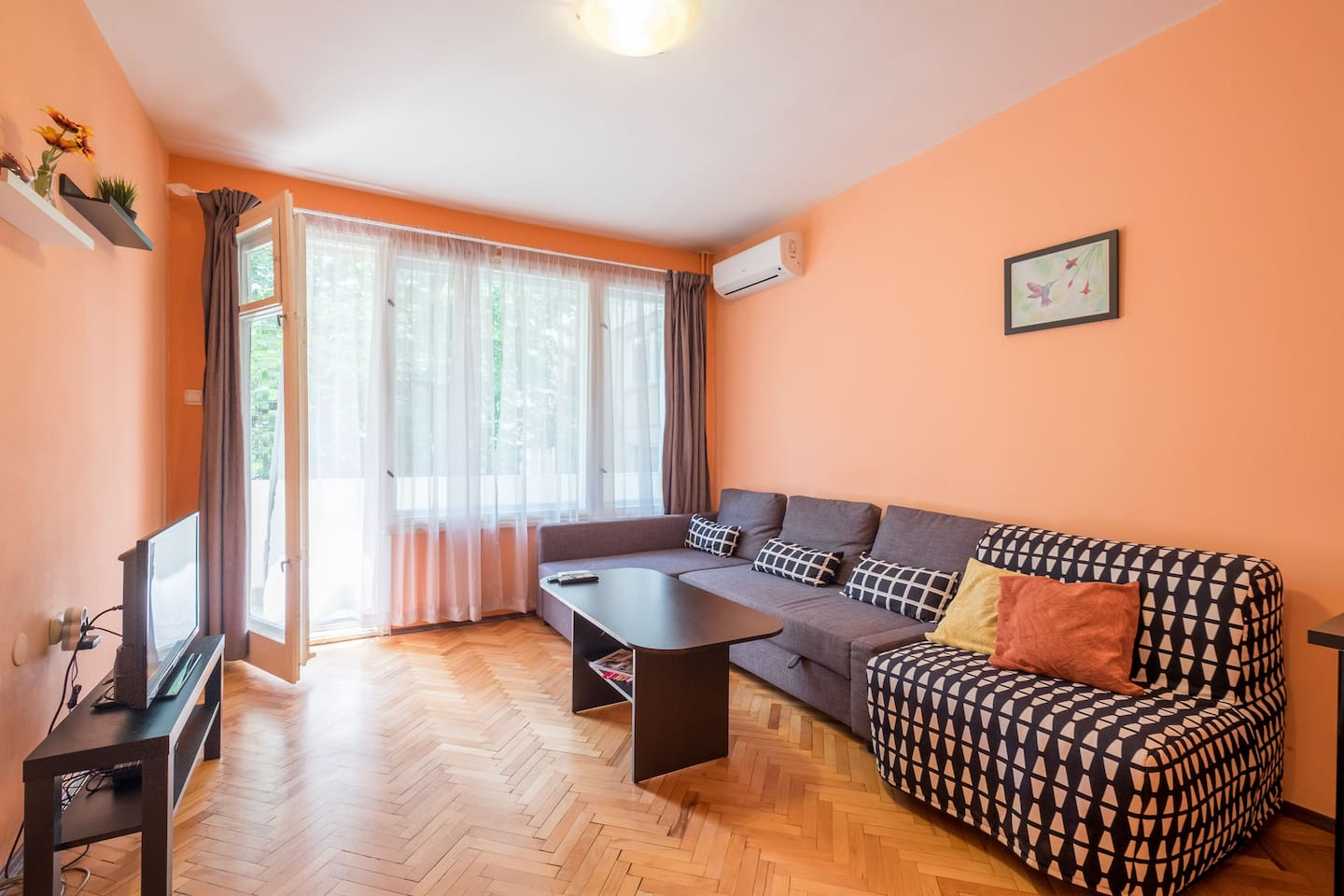 LIVING ROOM with A/C and expandable sofa to double bed as well as expandable single futon. Access to the balcony.