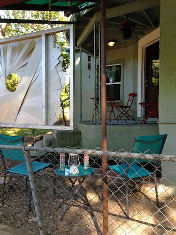 The front porch and yard have a couple of sitting spaces for you to enjoy outside.