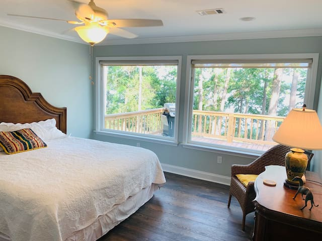 Additional views of the bedroom and scenery through large viewing windows