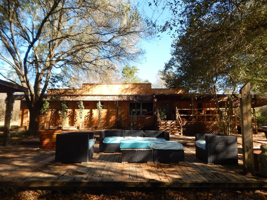 The Bar B Bunkhouse, sleeps up to 14 (incl two sofa sleepers and trundle bunkbed room). It is poolside/lakeside.