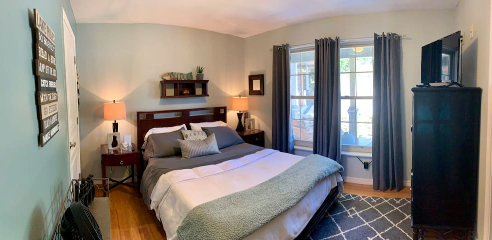 Queen bed and and queen corner bed bedroom share bath.  Screened porch off bedroom offers comfortable sitting area and an option to sleep outdoors.